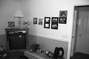 Other wall, tv, bench, some photos that I'm trying to sell